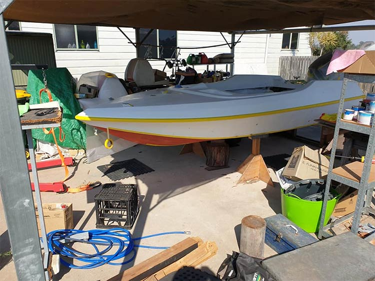 Pride Cheetah Ski boat on timber stands ready to repaint the hull